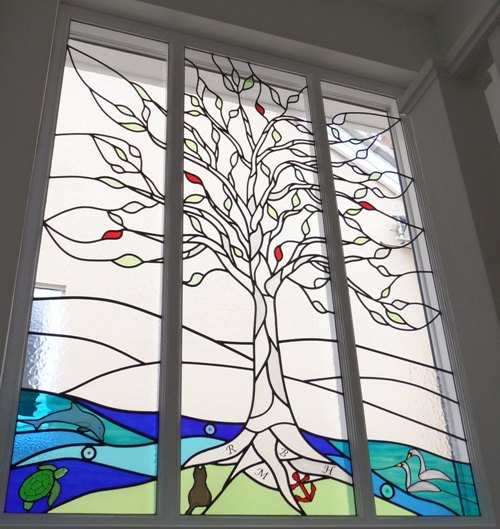 Stained glass tree and seascape